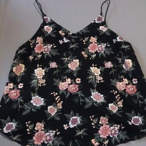Black tank top with flowers.